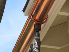 drilling holes at each downspout location